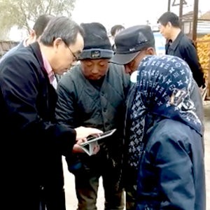 Dr. Jiaguo Qi demonstrates agro-forestry methods to residents in Heilongjiang, China. Photo credit: Bill McConnell